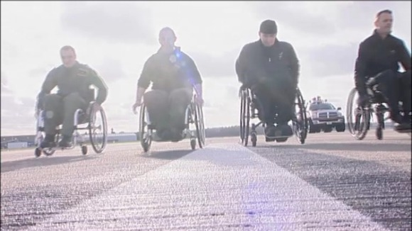 "Planes have been replaced with wheelchairs on the Northamptonshire runway for the charity challenge ""Push500""."