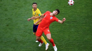 Harry Maguire scores England's first goal against Sweden.