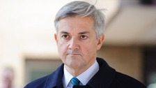 Chris Huhne leaving court today