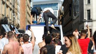 Fans on Police van