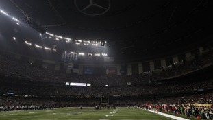 Play is halted after half of the lights went out during the Super Bowl game between the Baltimore Ravens and the San Francisco 49ers