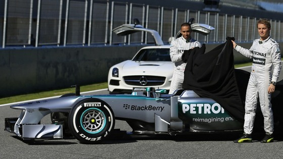 Lewis Hamilton and team mate Nico Rosberg of Germany unveil the new Mercedes W04 Formula One car