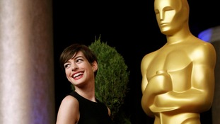 Anne Hathaway, nominated for Actress in a Supporting Role for Les Miserables, poses for photographers.
