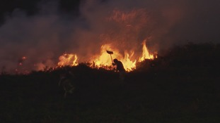 More than 50 firefighters tackle huge moorland fire