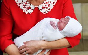 Prince Louis in his mother's arms on the steps of the Lindo Wing