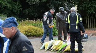 Bikers pay tribute to William Dunlop in the Dunlop memorial garden in Ballymoney