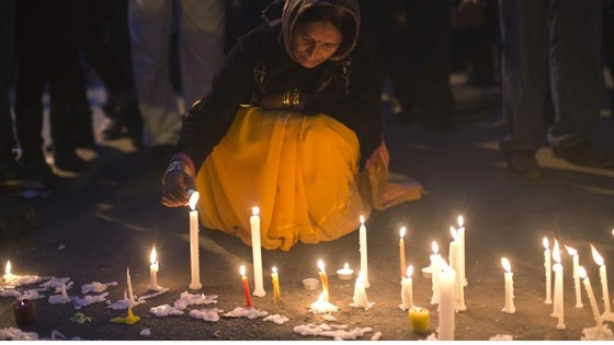 A demonstrator lights candles during a vigil for the victim who was assaulted in New Delhi, on December 29.