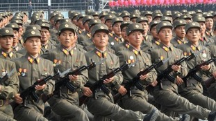 Military personnel participate in a parade in Pyongyang in October, 2010.