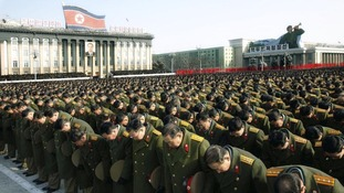 North Koreans gather during a memorial for the late North Korean leader Kim Jong-il, in 2011.