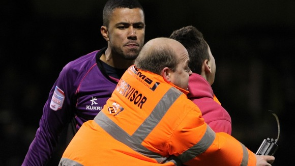 The teenager was dragged away by stewards after confronting Archer (left)