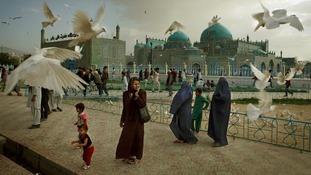 Families visit the shrine of Hazrat Ali, or the Blue Mosque, in Mazar-i-Sharif in Afghanistan.