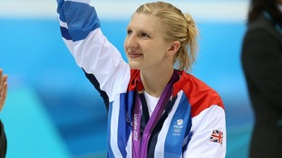 Rebecca Adlington waves to the crows after the medal ceremony for the Women's 800m Freestyle at London 2012
