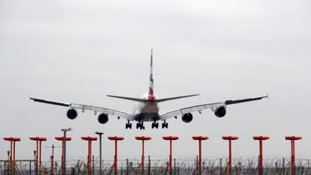 Plane lands at Heathrow Airport