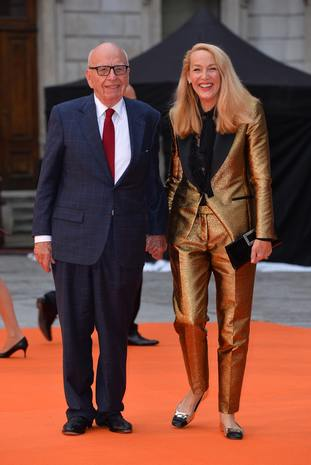 Rupert Murdoch, pictured with wife Jerry Hall, has already agreed to sell Fox assets including its Sky stake to Walt Disney (PA)