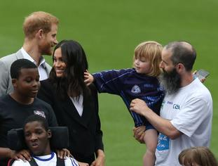 A boy reaches out to touch Meghan's hair during the visit to Croke Park (Brian Lawless/PA)