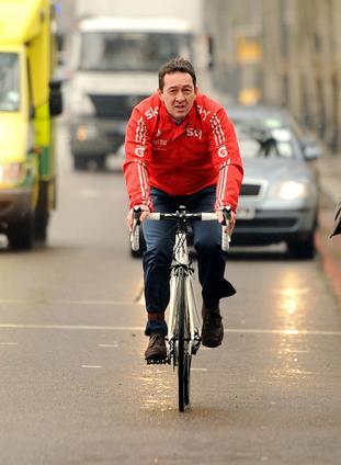 Chris Boardman on his bike in London