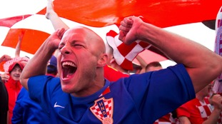 A Croatia fan gets in the mood for the match.