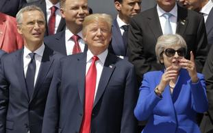 Donald Trump, Theresa May and others watch a flypast in Brussels