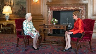 Don't sit down until the Queen offers a chair.