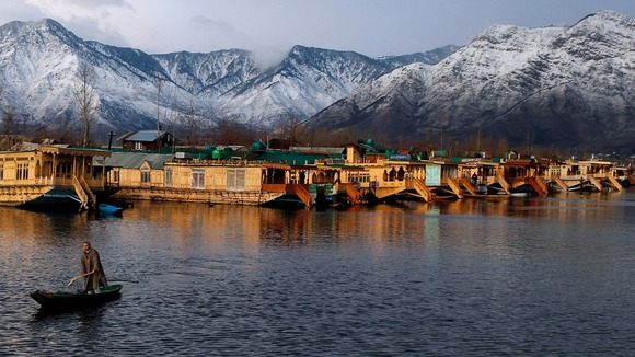 Mountains line the lake in Kashmir