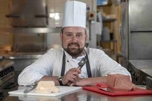 Chef Vladimirs Kruus showcases the ice cream alongside the square sausage (Gareth Easton)