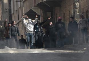 Anti-Syrian government protesters flash victory signs in 2011 in Daraa