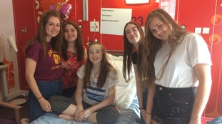 Molly's friends visit her in hospital.