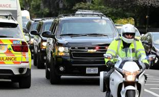 A motorcade arrives at Winfield House