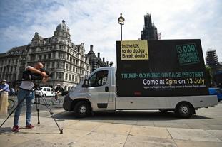 Demonstrators drive a Go Home van around Westminster