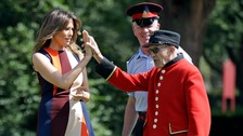 First Lady Melania Trump high-fived with a Chelsea Pensioner as she tried her hand at bowls.