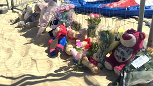 Floral tributes left at Gorleston beach in Norfolk where Ava-May was fatally thrown from an inflatable trampoline.