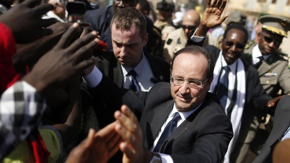 France&#x27;s President Francois Hollande greets people in the centre of Timbuktu on February 2 2013