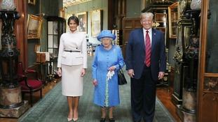 Donald Trump and his wife, Melania, pose in the Grand Corridor.