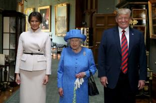 The Queen stands with US president Donald Trump and his wife, Melania