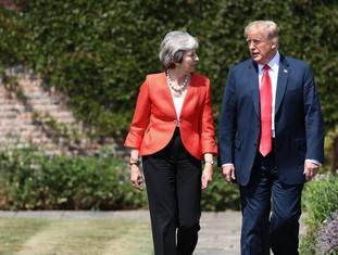 US President Donald Trump walks with Prime Minister Theresa May prior to a joint press conference