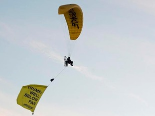 A Greenpeace protester flies over Turnberry