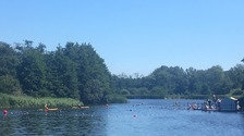 Festival-goers take to the lake to cool off at Latitude in Suffolk.