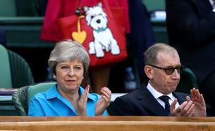 Mrs May and her husband Philip took their seats ready for the action.