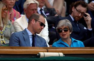 Prince William was in discussion with the prime minister just before the match got under way.