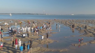Annual Bramble Bank cricket match in middle of Solent