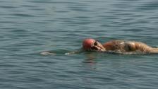 Jerseyman sets new world record for swimming twice round the island