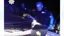 Police dashcam captures moment officer is knocked down by getaway driver