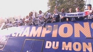 The World Cup held aloft on the victory bus.