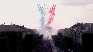 Jets painted the Champs-Elysees the famous French colours.