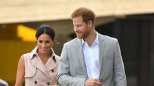 Harry and Meghan arrive for their visit to the Nelson Mandela centenary exhibition.