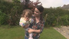 Jenni holding daughter Eryn in the garden