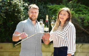 £1m Lotto Raffle winners Arron Walshaw and Ceri Hall (National Lottery/PA)