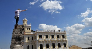 Alain Robert of France scales the walls of a school in the old quarter of Havana.