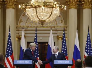 Donald Trump shakes hands with Vladimir Putin at the Presidential Palace in Helsinki.