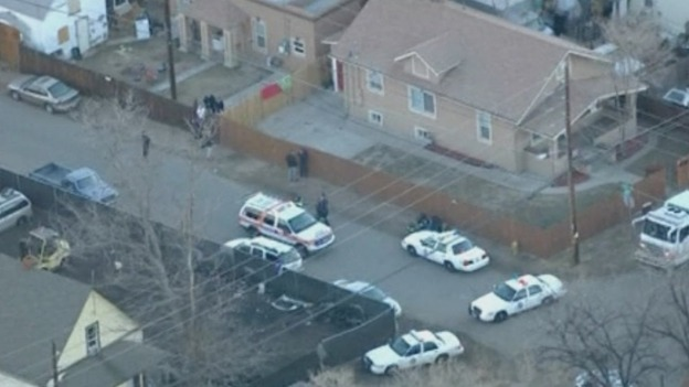Police surround the house where the fatal shooting tool place